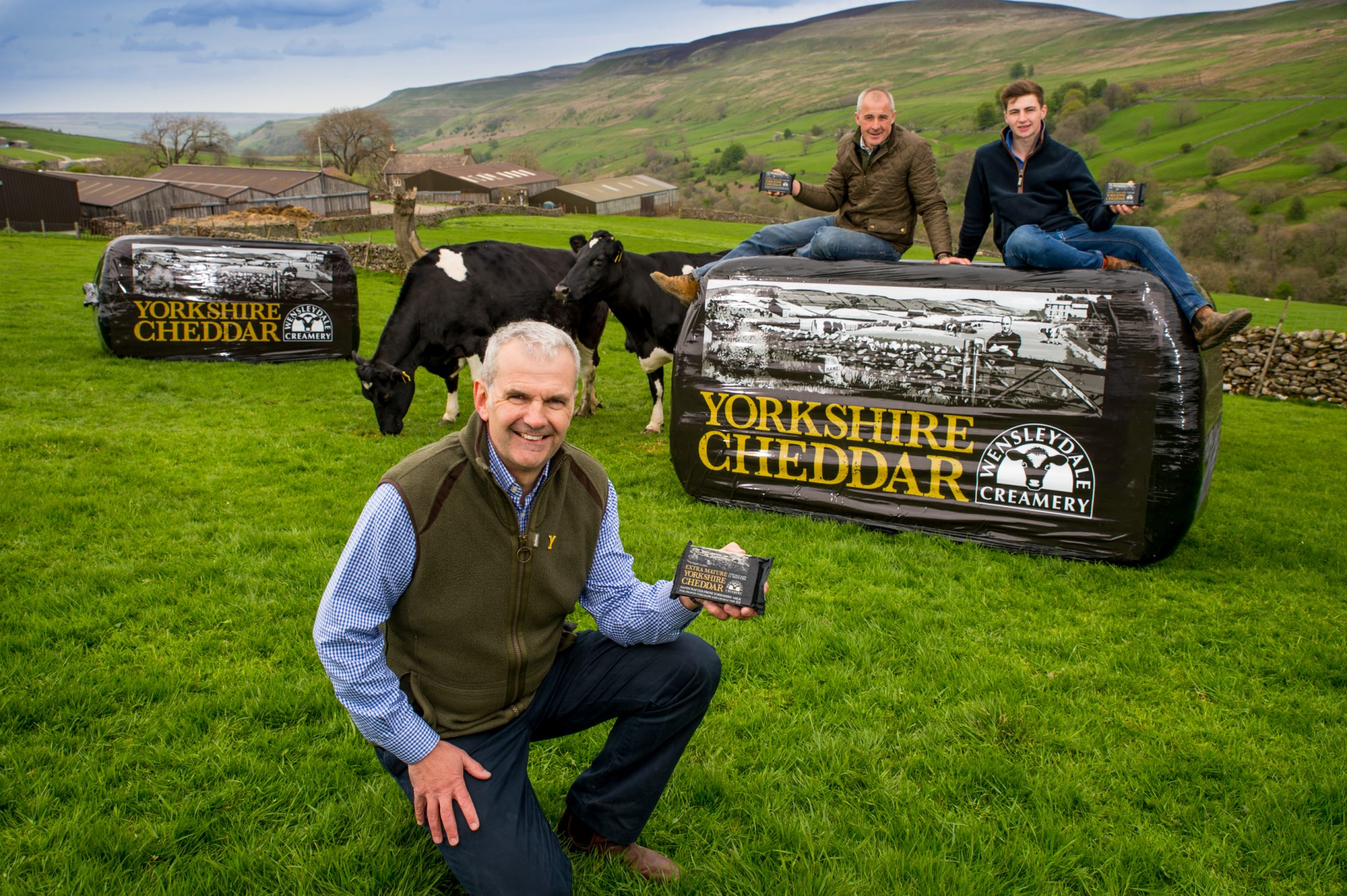 Wensleydale Creamery MD David Hartley and Wensleydale dairy farmer Robert Tiplady and son 2