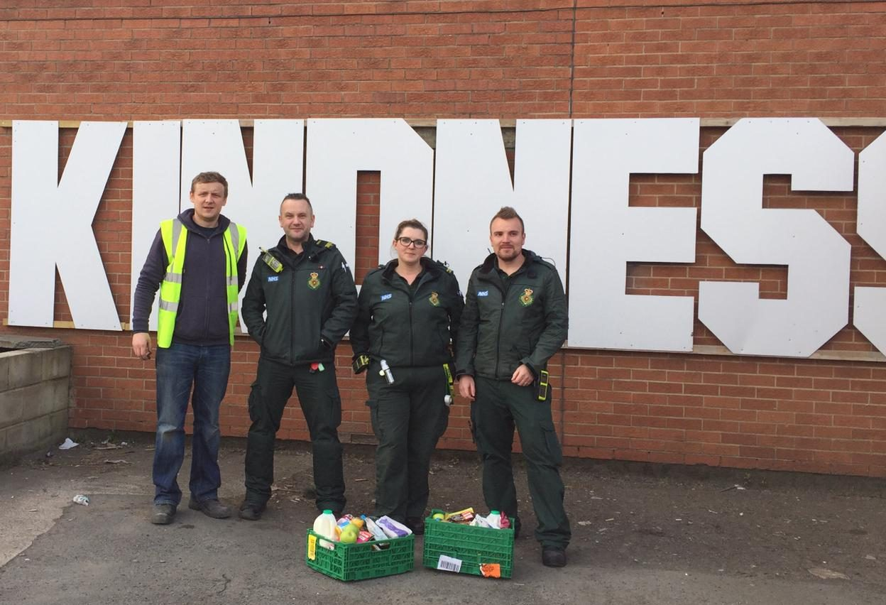 Adam Smith (left) with NHS workers and their food boxes