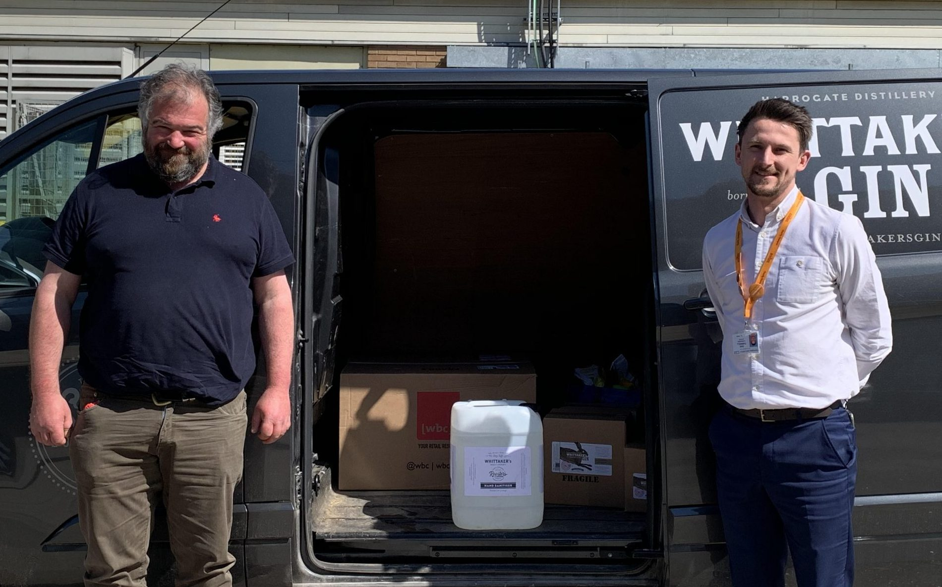L-r Toby Whittaker of Whittaker's Gin delivers the hand sanitiser to Dan Thirkell, charity fundraising manager at the Harrogate & District NHS Foundation Trust