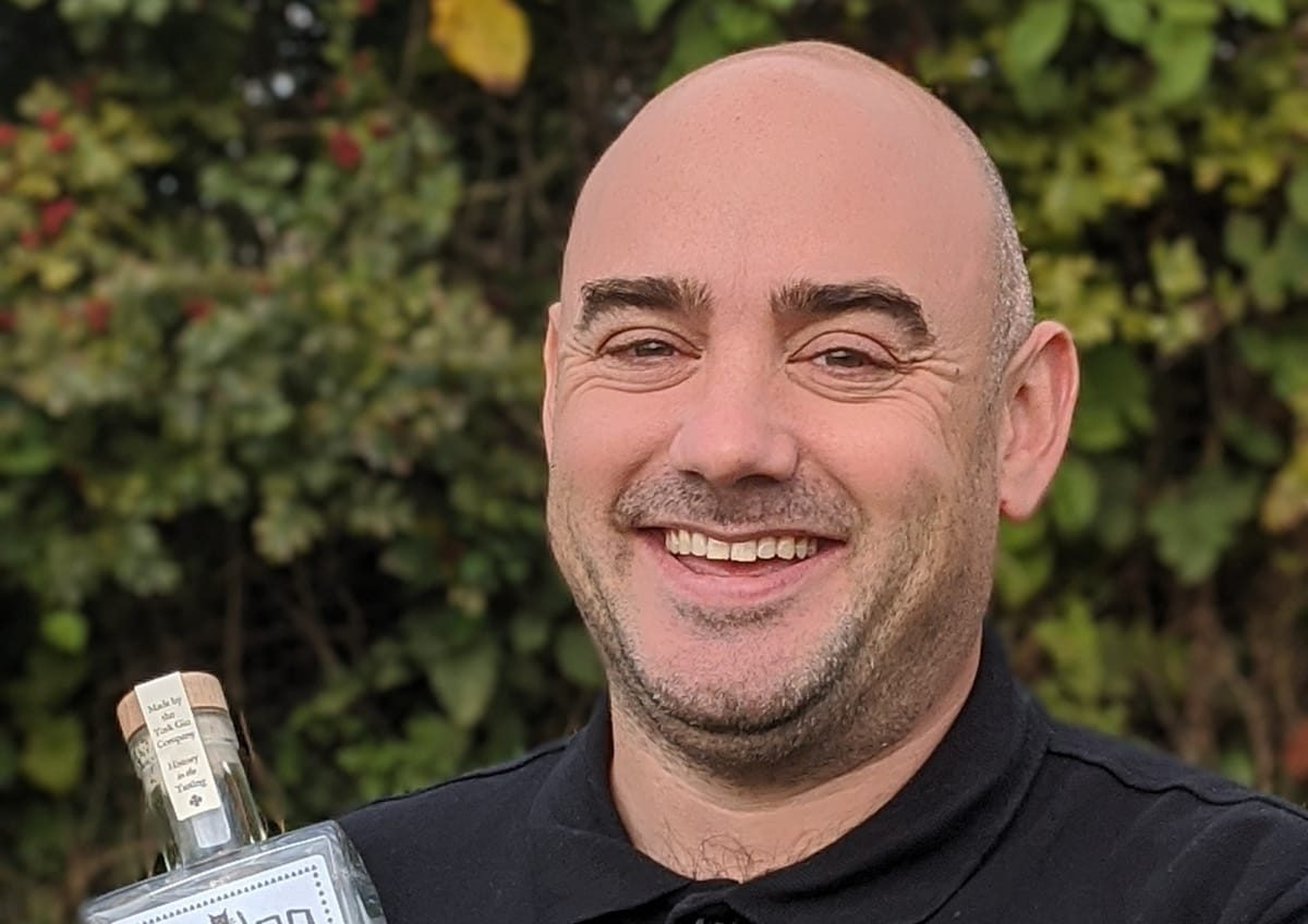 Adam Cook of York Gin holding a bottle of York Gin Grey Lady
